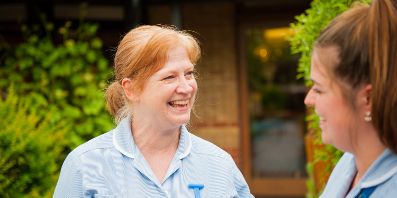 Two St Clare Hospice nurses laughing